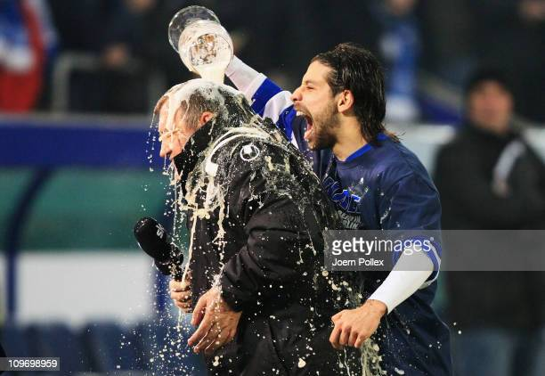 Head coach Milan Sasic of Duisburg gets a beer shower from Olcay Sahan after winning the DFB Cup semi final match beween MSV Duisburg and Energie...