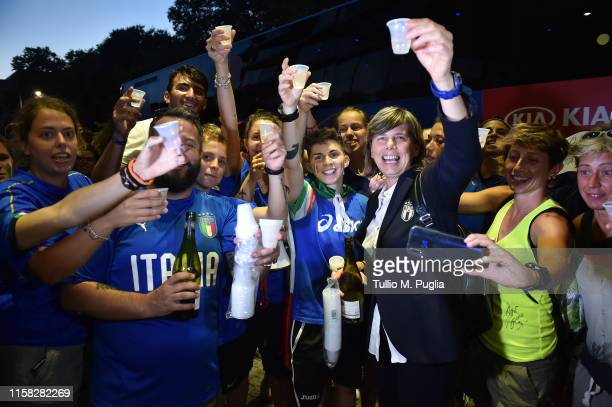 Head coach Milena Bertolini of Italy makes a toast with supporters as they welcome the team at Crown Plaza after winning the 2019 FIFA Women's World...