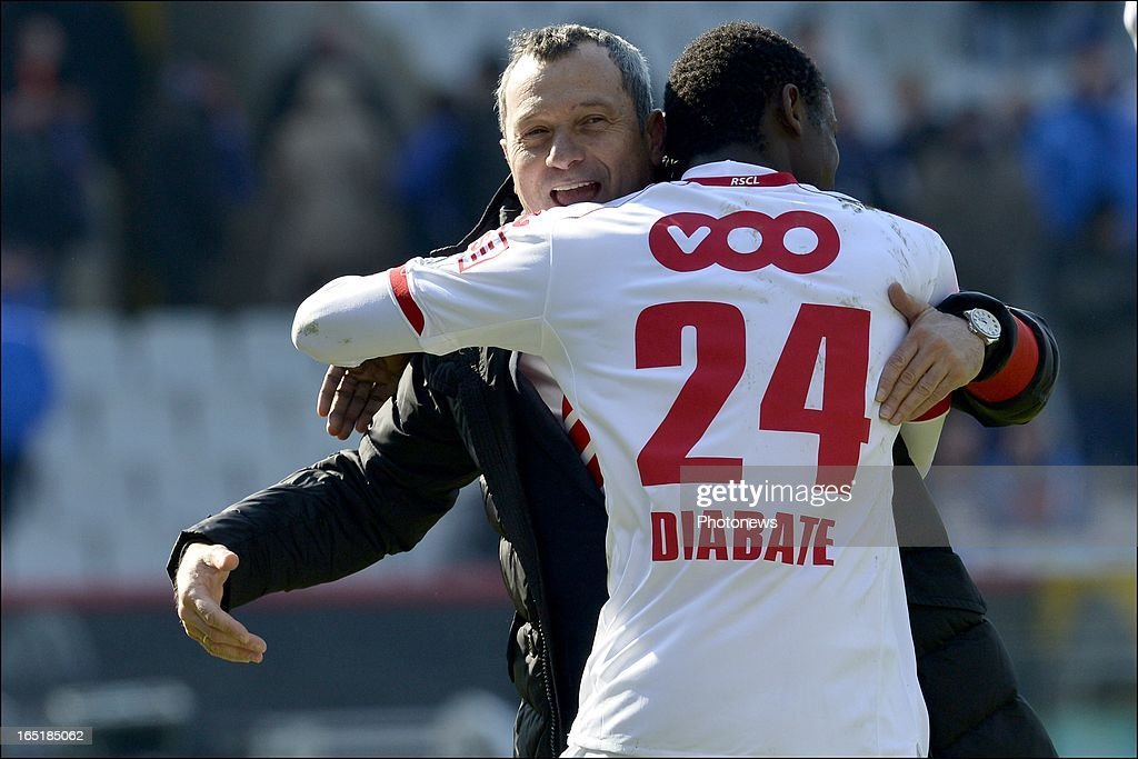 Head coach Mircea Rednic of Standard celebrates the victory with Zie Diabate of Standard after the Jupiler League match between Club Brugge and Standard de Liege on April 01, 2013 in the Jan Breydel Stadium in Brugge, Belgium.