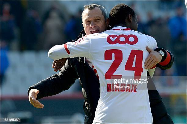 Head coach Mircea Rednic of Standard celebrates the victory with Zie Diabate of Standard after the Jupiler League match between Club Brugge and...