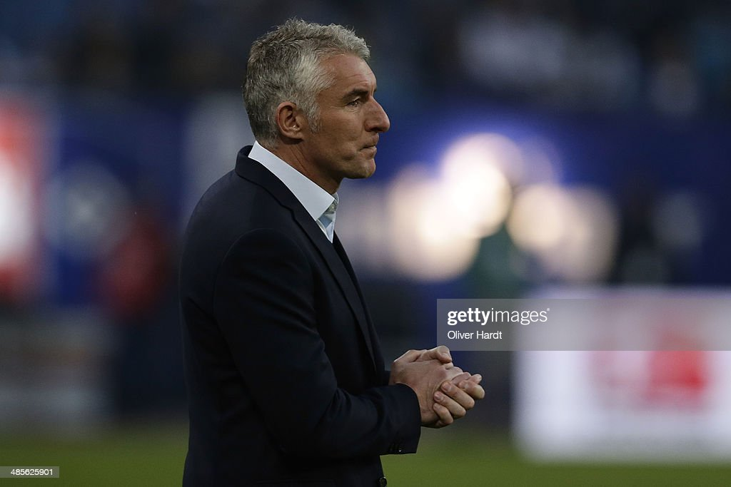 Head coach Mirko Slomka of Hamburg appears frustrated after the Bundesliga match between Hamburger SV and VfL Wolfsburg at Imtech Arena on April 19, 2014 in Hamburg, Germany.