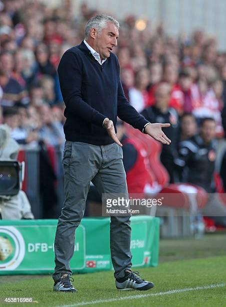 Head coach Mirko Slomka of Hamburg gestures during the DFB Cup match between FC Energie Cottbus and Hamburger SV at Stadion der Freundschaft on...