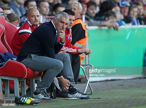 Head coach Mirko Slomka of Hamburg looks on during the DFB Cup match between FC Energie Cottbus and Hamburger SV at Stadion der Freundschaft on...