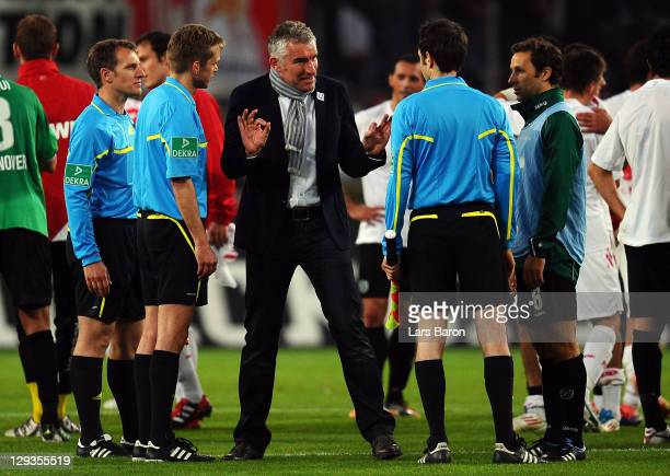 Head coach Mirko Slomka of Hannover discusses with referee Jochen Drees after loosing the Bundesliga match between 1. FC Koeln and Hannover 96 at...