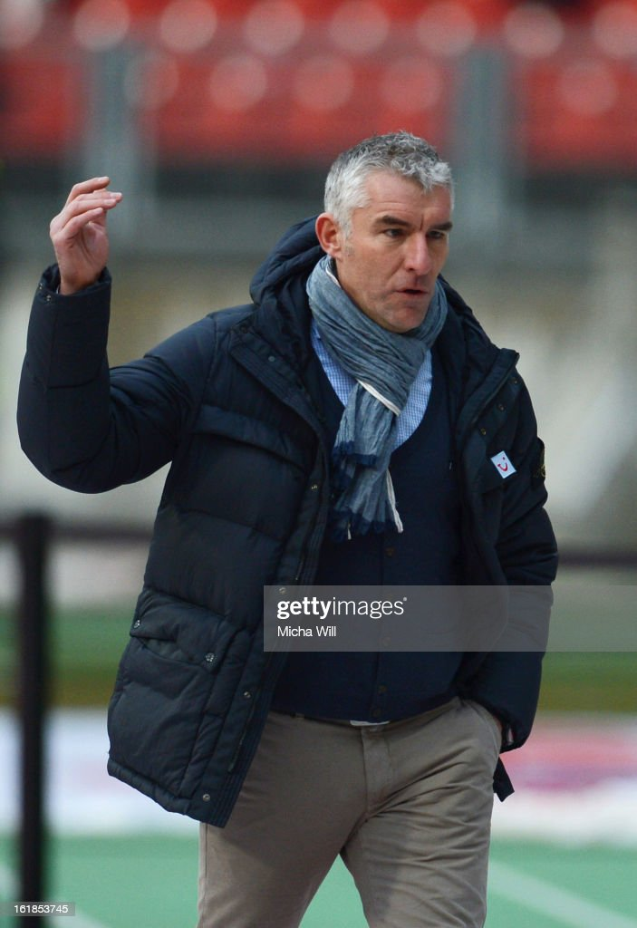 Head coach Mirko Slomka of Hannover has to leave the pitch and watch from the main stand during the Bundesliga match between 1. FC Nuernberg and Hannover 96 at Grundig-Stadion on February 17, 2013 in Nuremberg, Germany.