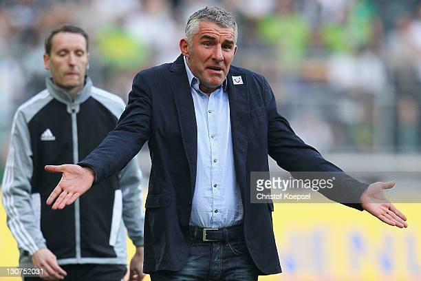 Head coach Mirko Slomka of Hannover looks dejected during the Bundesliga match between Borussia Moenchengladbach and Hannover 96 at Borussia Park...