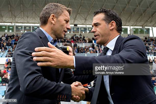 Head coach Miroslav Djukic of Valencia CF is welcomed by head coach Luis Garcia of Getafe CF prior to start the La Liga match between Getafe CF and...