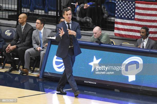 Head coach Mitch Henderson of the Princeton Tigers signals his players during a college basketball game against the Princeton Tigers at the Smith...