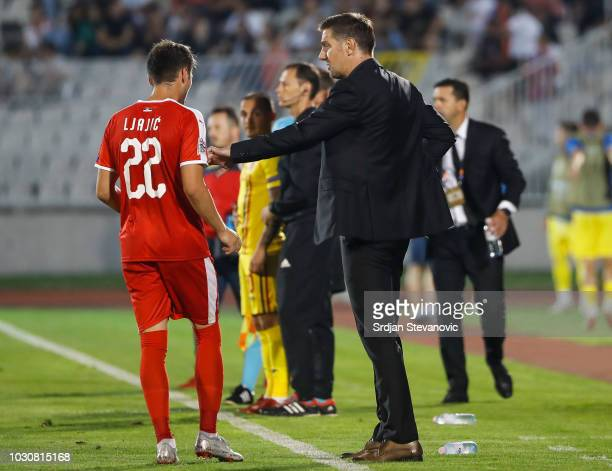 Head coach Mladen Krstajic of Serbia speaks to the Adem Ljajic during the UEFA Nations League C group four match between Serbia and Romania at...