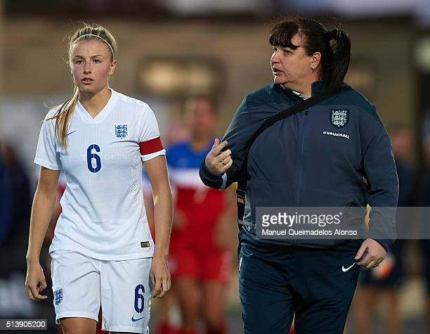 Head coach Mo Marley of England gives instructions to Leah Williamson during the women's U19 international friendly match between England U19 and USA...