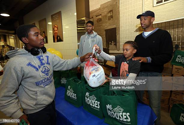 Head Coach Monty Williams and forward Anthony Davis distribute Thanksgiving baskets provided by the Hornets and Rouses to Emerge students on November...