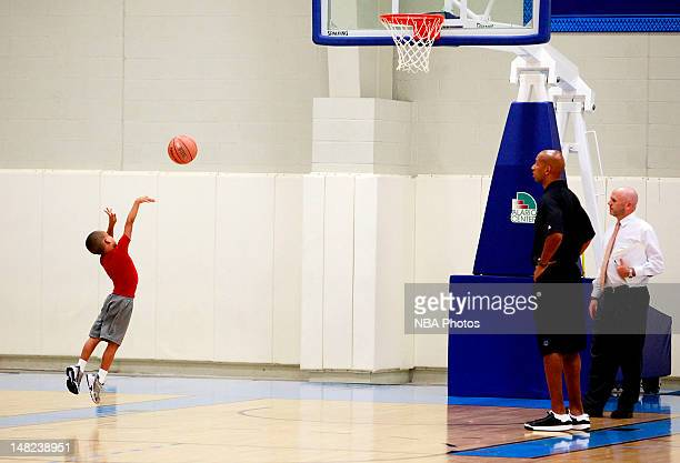 Head coach Monty Williams of the New Orleans Hornets watches his son shoot baskets at practice on July 12 2012 at the Alerio Center in New Orleans...