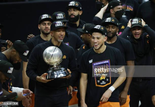Head Coach Monty Williams of the Phoenix Suns holds the Western Conference Championship trophy as his team looks on after the Suns defeated the LA...