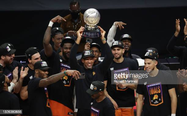 Head Coach Monty Williams of the Phoenix Suns holds the Western Conference Champion trophy after the Suns defeated the LA Clippers in Game Six of the...