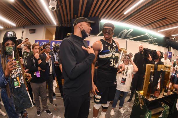 Head Coach Monty Williams of the Phoenix Suns talks to Giannis Antetokounmpo of the Milwaukee Bucks and the Milwaukee Bucks after Game Six of the...