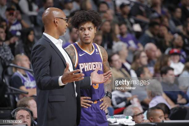 Head coach Monty Williams talks with Kelly Oubre Jr #3 of the Phoenix Suns during the game against the Sacramento Kings during the preseason on...