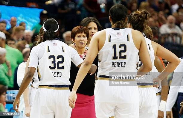 Head coach Muffet McGraw of the Notre Dame Fighting Irish and her team react in the second half against the South Carolina Gamecocks during the NCAA...