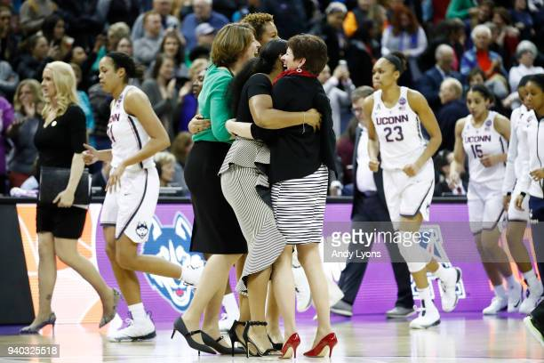 Head coach Muffet McGraw of the Notre Dame Fighting Irish celebrates with her staff after her team defeated the Connecticut Huskies in overtime in...