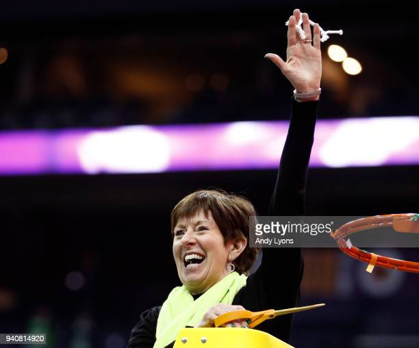 Head coach Muffet McGraw of the Notre Dame Fighting Irish cuts down the net after her team defeated the Mississippi State Lady Bulldogs in the...