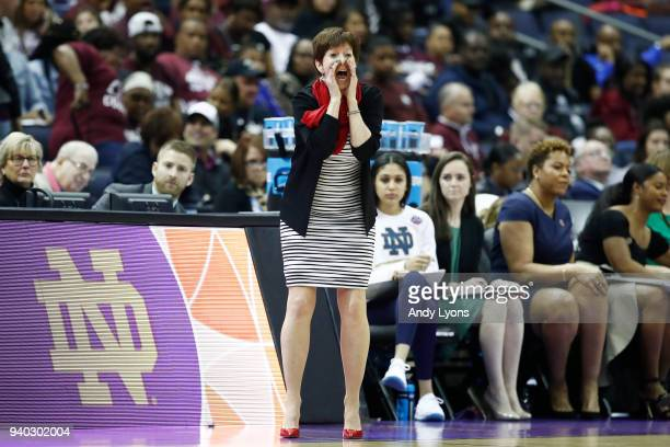 Head coach Muffet McGraw of the Notre Dame Fighting Irish instructs her team against the Connecticut Huskies during the first half in the semifinals...
