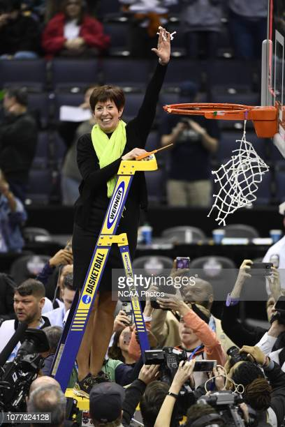 Head coach Muffet McGraw of the Notre Dame Fighting Irish waves a piece of the net during the championship game of the 2018 NCAA Photos via Getty...