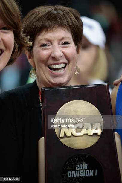 Head coach Muffet McGraw of the The Notre Dame Fighting Irish celebrates with the trophy after defeating the Oregon Ducks 8474 in the 2018 NCAA...
