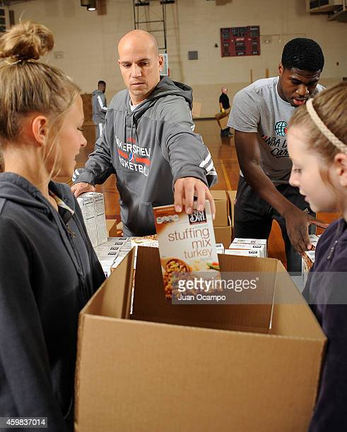 Head coach Nate Bjorkgren of the Bakersfield Jam helps fill a Thanksgiving dinner box during the Bakersfield Jam Thanksgiving Box Give Away Event on...