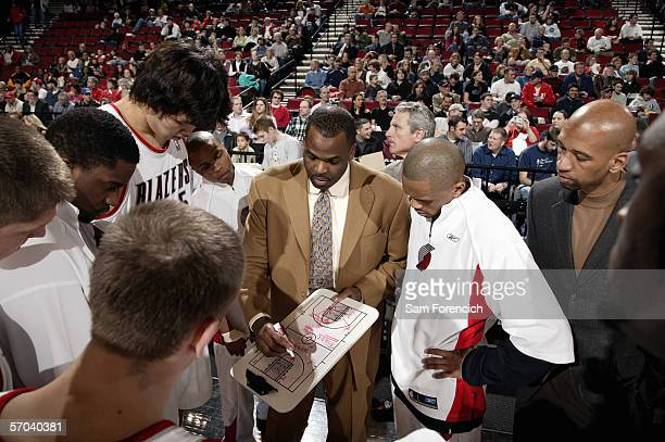 Head coach Nate McMillan of the Portland Trail Blazers diagrams a play for his team during the game against the Charlotte Bobcats on February 22 2006...