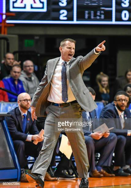 Head Coach Nate Oats of the Buffalo Bulls yells across the court during the NCAA Division I Men's Championship First Round basketball game between...