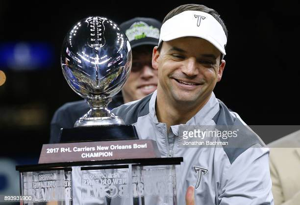 Head coach Neal Brown of the Troy Trojans celebrates with the trophy after the RL Carriers New Orleans Bowl against the North Texas Mean Green at the...