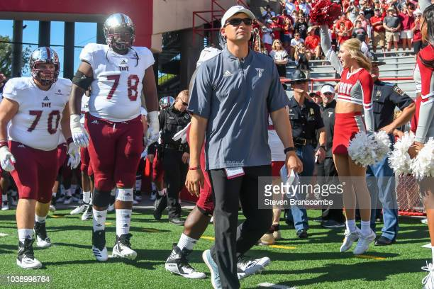 Head coach Neal Brown of the Troy Trojans leads the team on the field before the game against the Nebraska Cornhuskers at Memorial Stadium on...