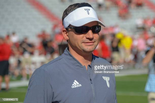Head coach Neal Brown of the Troy Trojans watches the team warm up before the game against the Nebraska Cornhuskers at Memorial Stadium on September...