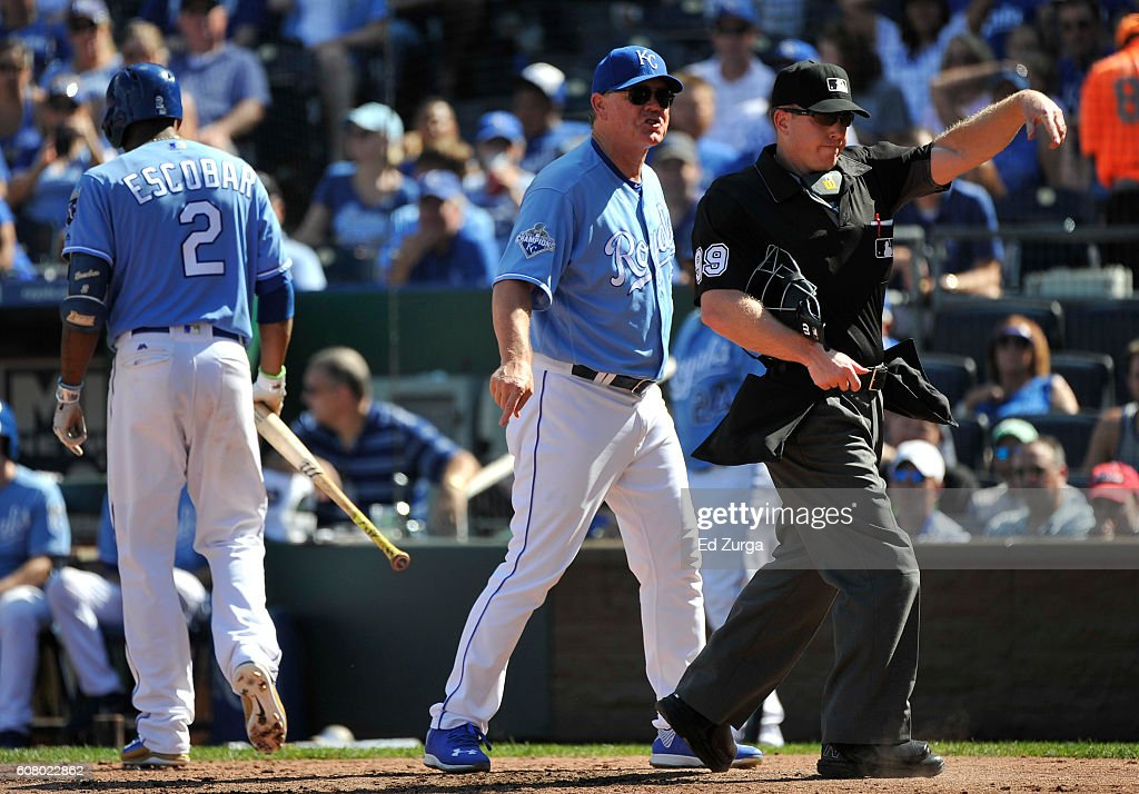 Head coach Ned Yost #3 of the Kansas City Royals is ejected from the game by umpire Toby Basner as Alcides Escobar #2 walks to the dugout after he was ejected from the game in the fifth inning against the Chicago White Sox at Kauffman Stadium on September 19, 2016 in Kansas City, Missouri.