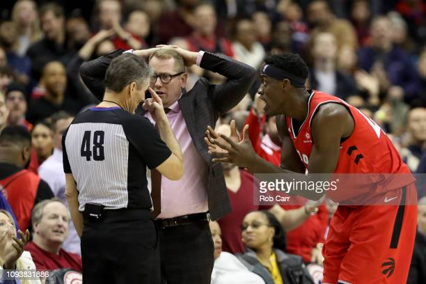 Head coach Nick Nurse of the Toronto Raptors and Pascal Siakam argue with referee Scott Foster in overtime against the Washington Wizards Capital One...