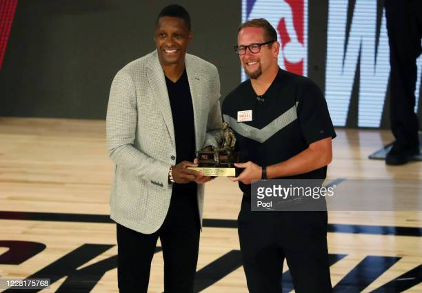Head coach Nick Nurse of the Toronto Raptors is presented the NBA Coach of the Year award by team president Masai Ujiri before game four of the first...