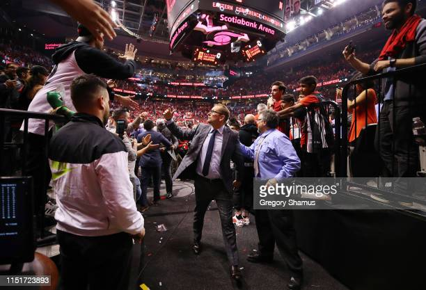 Head coach Nick Nurse of the Toronto Raptors walks off the court after defeating the Milwaukee Bucks 10094 in game six of the NBA Eastern Conference...