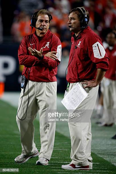 Head coach Nick Saban and Defensive coordinator Kirby Smart of the Alabama Crimson Tide look on from the field during the 2016 College Football...