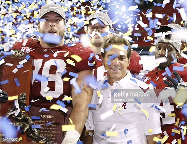 Head coach Nick Saban and Mike Johnson of the Alabama Crimson Tide celebrate after their 32-13 win against the Florida Gators during the SEC...