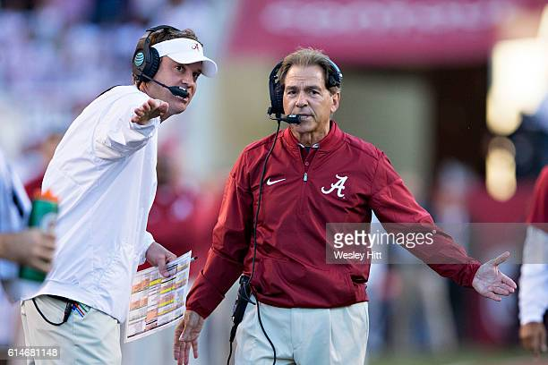 Head Coach Nick Saban and Offensive Coordinator Lane Kiffin of the Alabama Crimson Tide discuss a call during a game against the Arkansas Razorbacks...