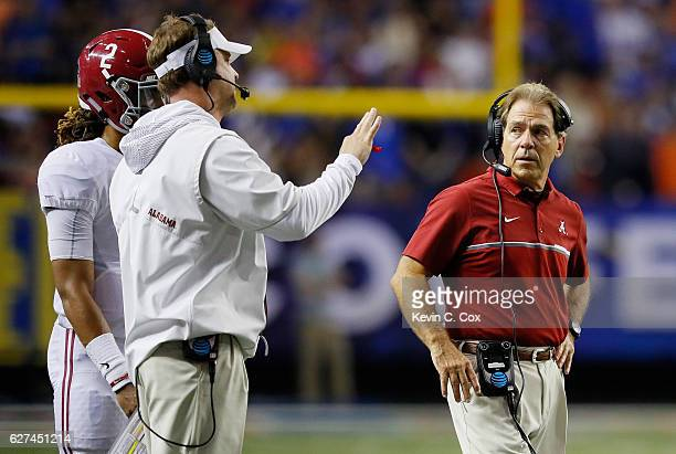 Head coach Nick Saban and Offensive Coordinator Quarterbacks Lane Kiffin talk to Jalen Hurts of the Alabama Crimson Tide in the second half against...