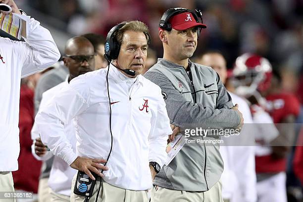 Head coach Nick Saban and offensive coordinator Steve Sarkisian of the Alabama Crimson Tide stand on the sideline during the second half of the 2017...