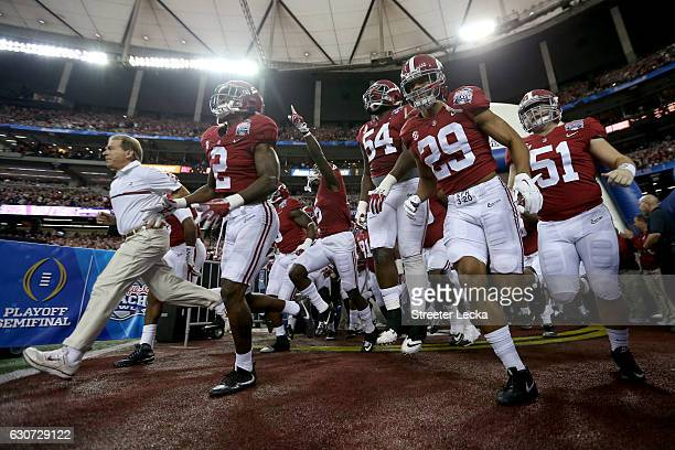 Head Coach Nick Saban and the Alabama Crimson Tide team take the field during the 2016 ChickfilA Peach Bowl at the Georgia Dome on December 31 2016...