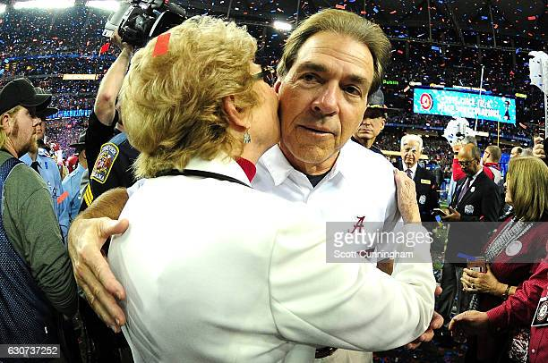 Head Coach Nick Saban celebrates with his mother Mary Saban after winning 24 to 7 against the Washington Huskies during the 2016 ChickfilA Peach Bowl...