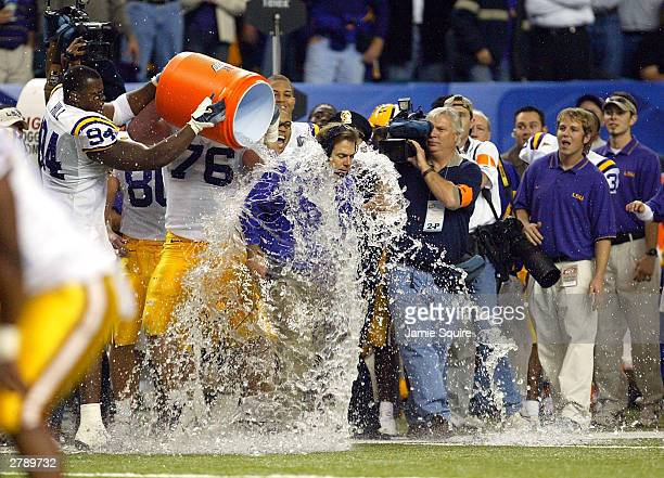 Head coach Nick Saban of LSU Tigers is drenched with water as the LSA Tigers defeated the Georgia Bulldogs to win the SEC Championship Game on...