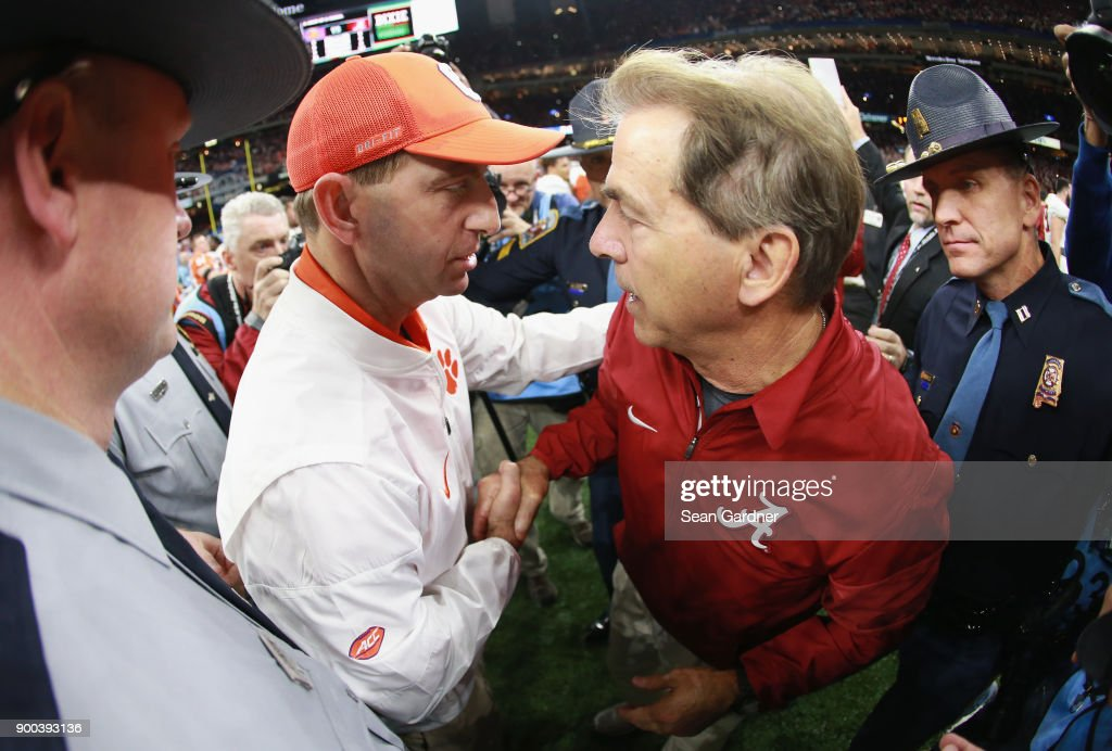 Head coach Nick Saban of the Alabama Crimson Tide and head coach Dabo Swinney of the Clemson Tigers greet after the AllState Sugar Bowl at the Mercedes-Benz Superdome on January 1, 2018 in New Orleans, Louisiana.