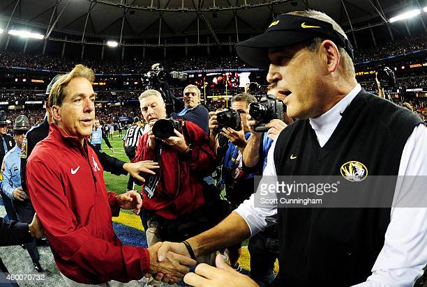 Head coach Nick Saban of the Alabama Crimson Tide and head coach Gary Pinkel of the Missouri Tigers shake hands after the Crimson Tide defeated the...