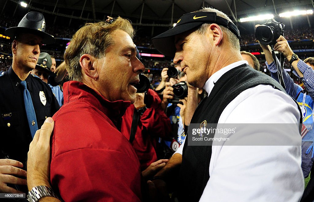 Head coach Nick Saban of the Alabama Crimson Tide and head coach Gary Pinkel of the Missouri Tigers embrace after the Crimson Tide defeated the Tigers 42 to 13 in SEC Championship game at the Georgia Dome on December 6, 2014 in Atlanta, Georgia.