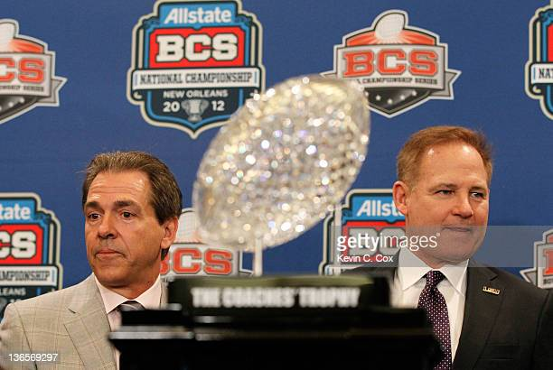 Head coach Nick Saban of the Alabama Crimson Tide and head coach Les Miles of the LSU Tigers pose with The Coaches' Trophy during the Allstate BCS...