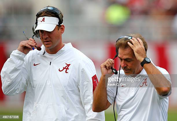 Head coach Nick Saban of the Alabama Crimson Tide and offensive coordinator Lane Kiffin converse against the Louisiana Monroe Warhawks at BryantDenny...