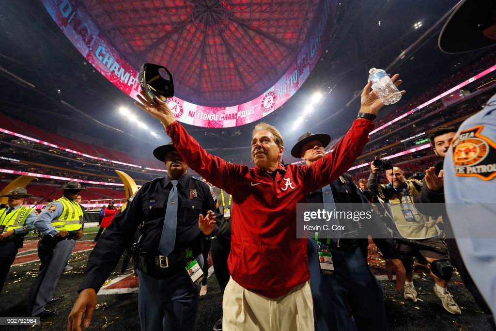 Head coach Nick Saban of the Alabama Crimson Tide celebrates beating the Georgia Bulldogs in overtime to win the CFP National Championship presented by AT&T at Mercedes-Benz Stadium on January 8, 2018 in Atlanta, Georgia. Alabama won 26-23.